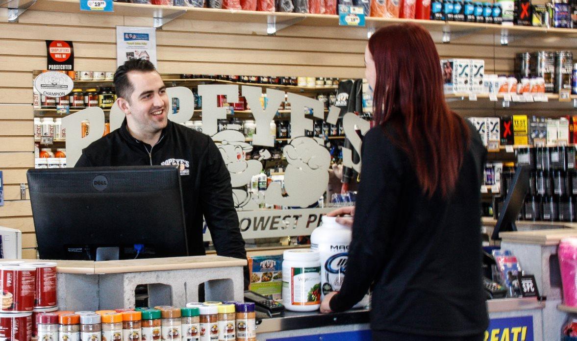 Photo of popeye's customer at till