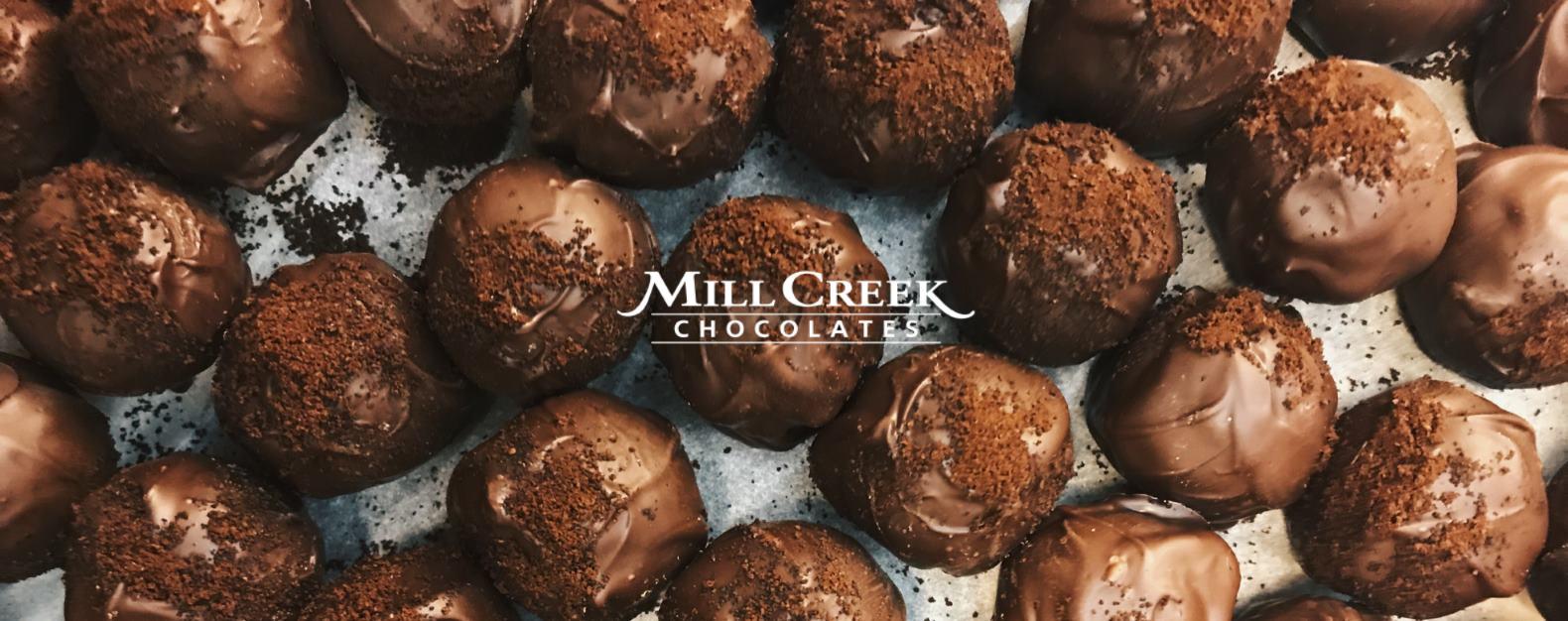 Chocolates and Mill Creek Chocolates logo