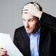 Surprised businessman reads statement